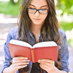 Adult student reading a literature text