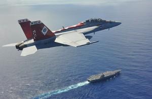 F-A-18F_flies_above_USS_George_Washington_in_Philippine_Sea._(9568001195)