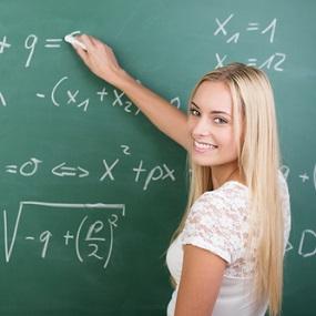 Higher Level GCSE Maths Student writing on a blackboard