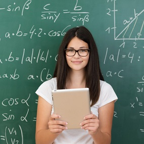 Maths Student in front of board covered in equations